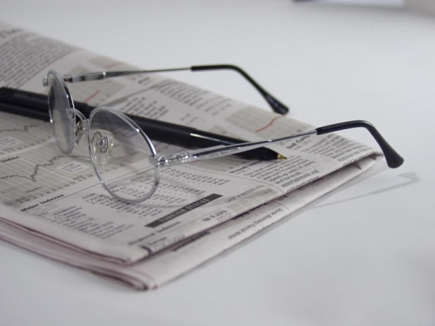 Eyeglasses on a newspaper