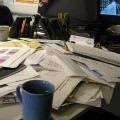 Cluttered desk full of paperwork