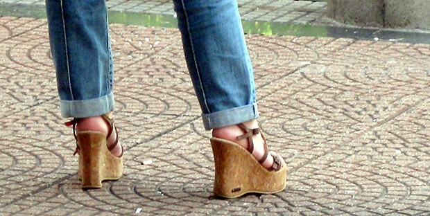 woman in jeans wearing wedges