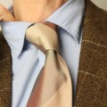 Man losening neck tie